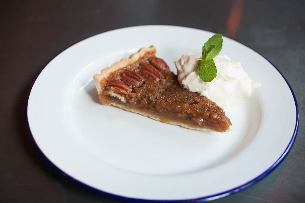 Pecan pie with whipped cream. Salty, crunchy sticky, yum…