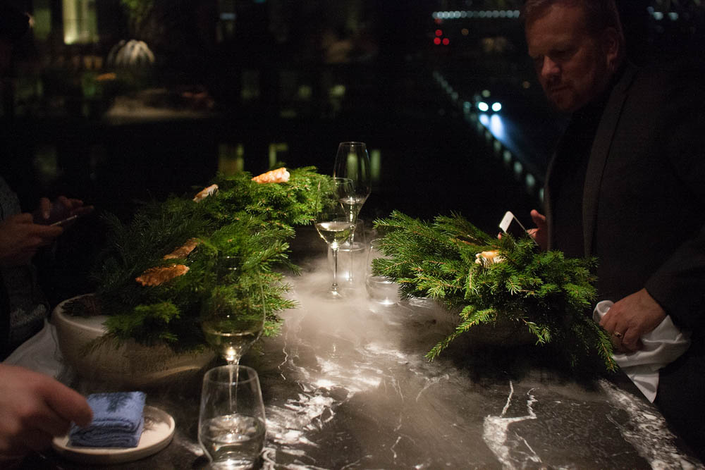The famous langoustine serving, with pickled spruce and cold pressed rapeseed oil poured over dry ice to create a vapor that smells of the Norwegian forest