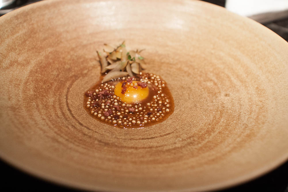"Charred onions and quail egg gently cooked in roasted bone marrow, with aged ""fenalår"" and onion vinaigrette."