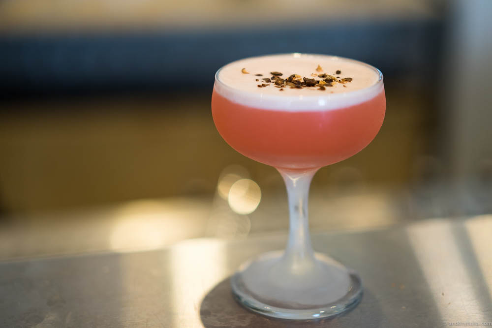 """Tadvin"" made of Braastad VS, Campari, lemon juice, raspberry syrup, egg white and sprinkled with crushed coffee beans."
