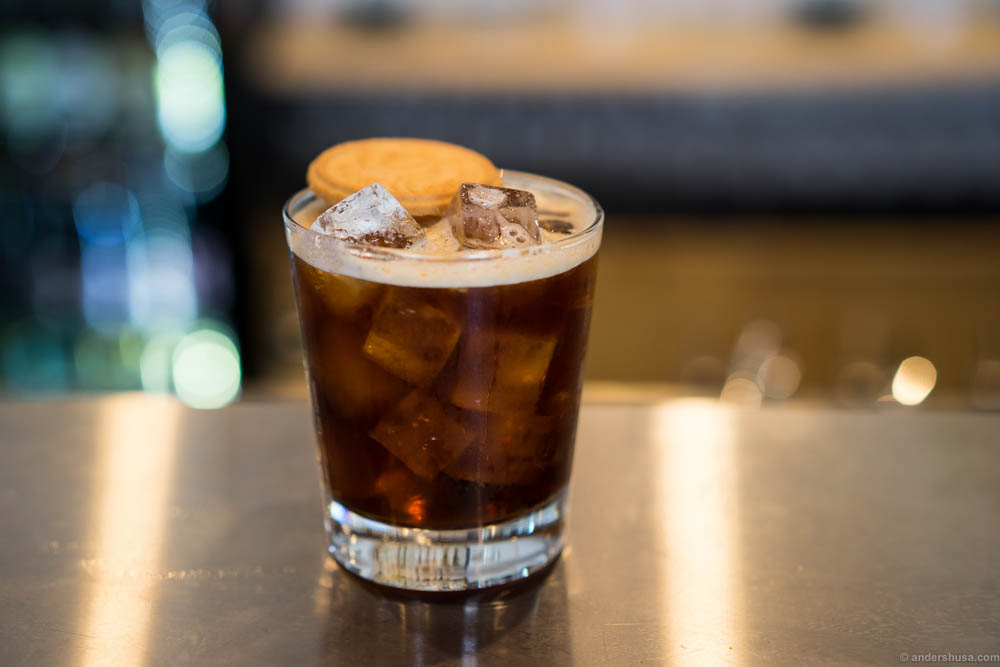 """Lidelsen er lykkens pris"" is made of Vikingfjord vodka, Créme de Cacao, Fernet Branca & Cold Joe which is ice coffee. And yes, that is a Gjende cookie!"