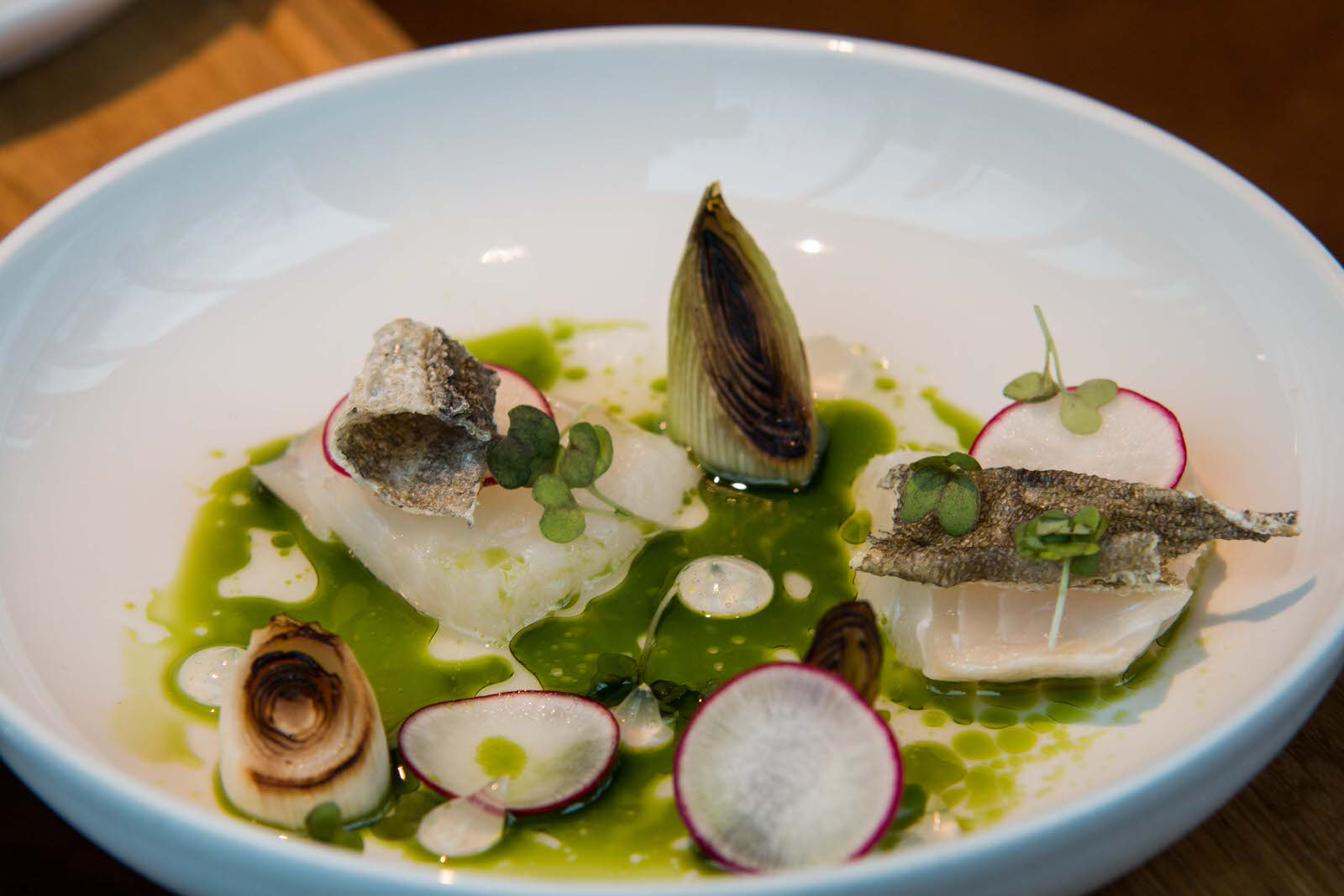 Salt cured halibut with dill, fish stock, fluid gel of brawn and crispy fish skin. Photo by: Arnold Lan.