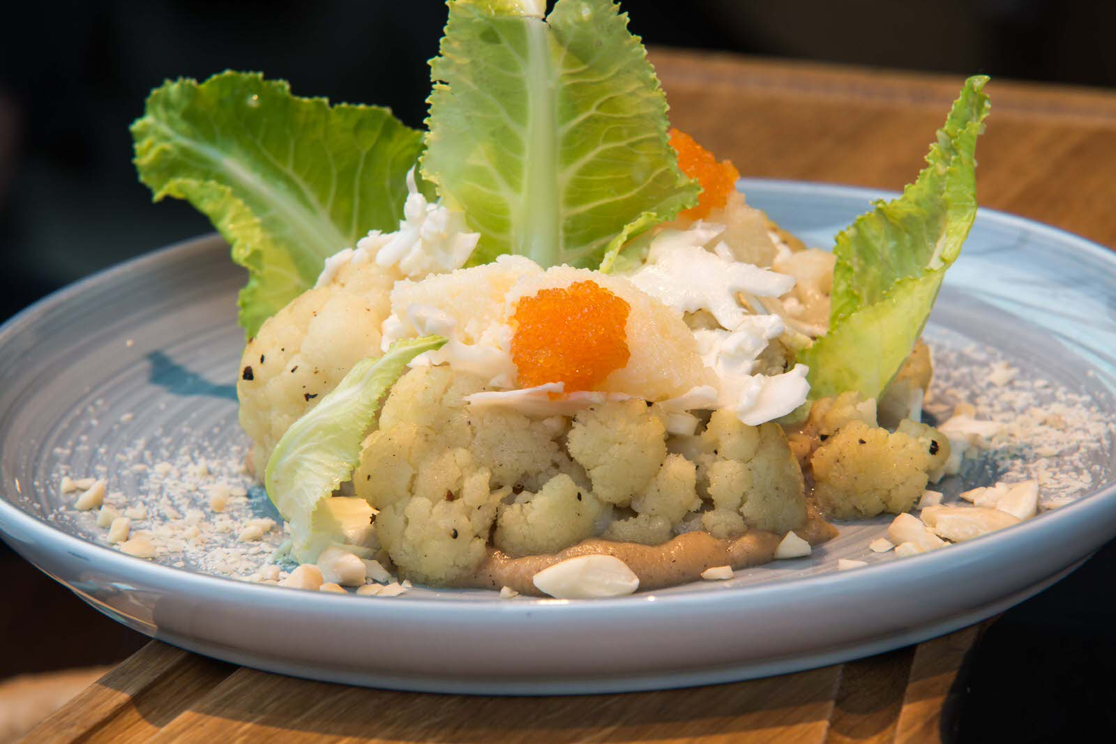 Variations of cauliflower (cooked, raw and puree) with capelin roe and toasted almonds