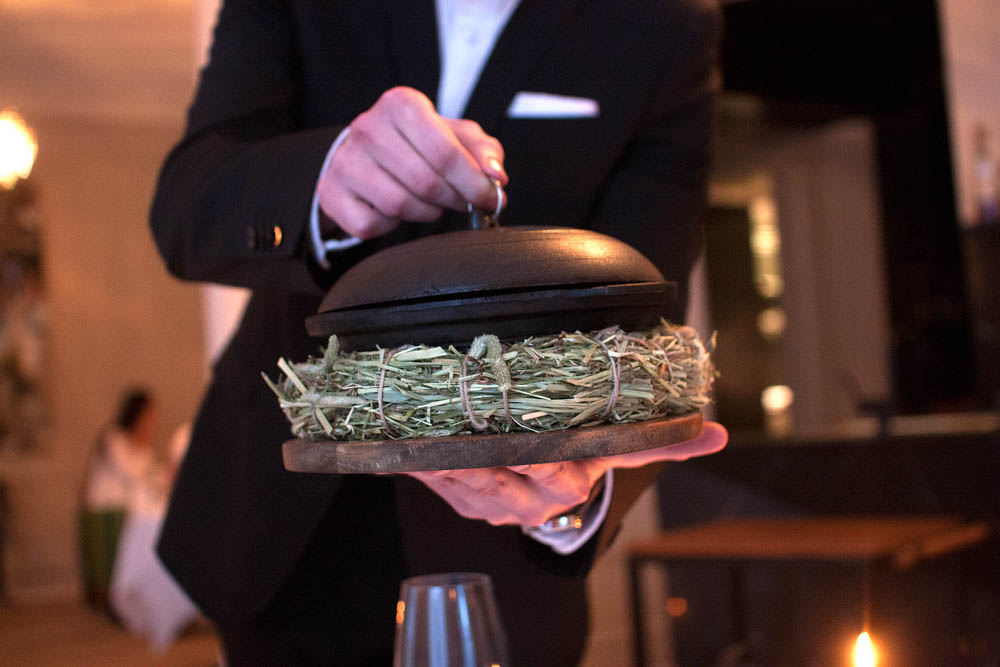 Our waiter presented parts of the 13th dish to be served while it was in the making.