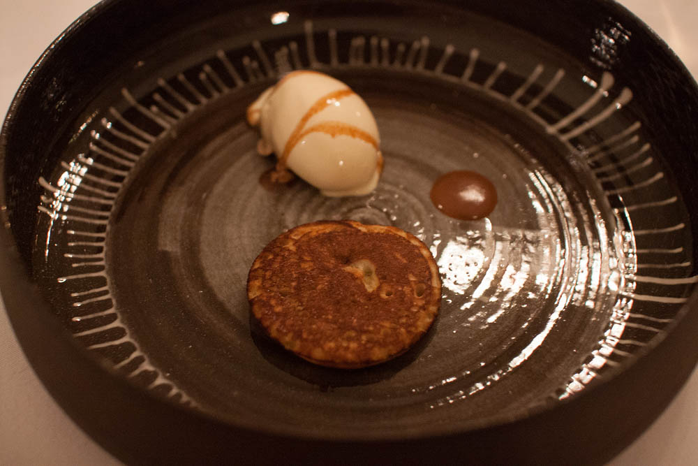 "Traditional Norwegian ""svele"", a thick pancake, with hazelnut ice cream, prune syrup and salty caramel"