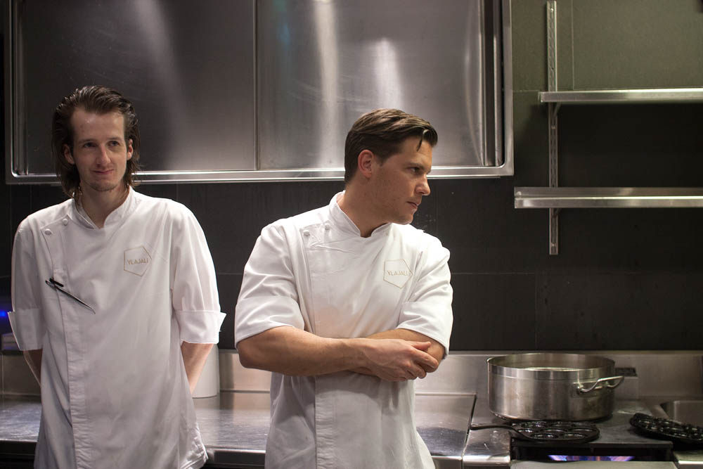 Chefs in the kitchen. Matthias Bernwieser on the right