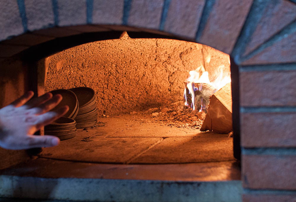 The wood-fired oven where they prepare a lot of the dishes