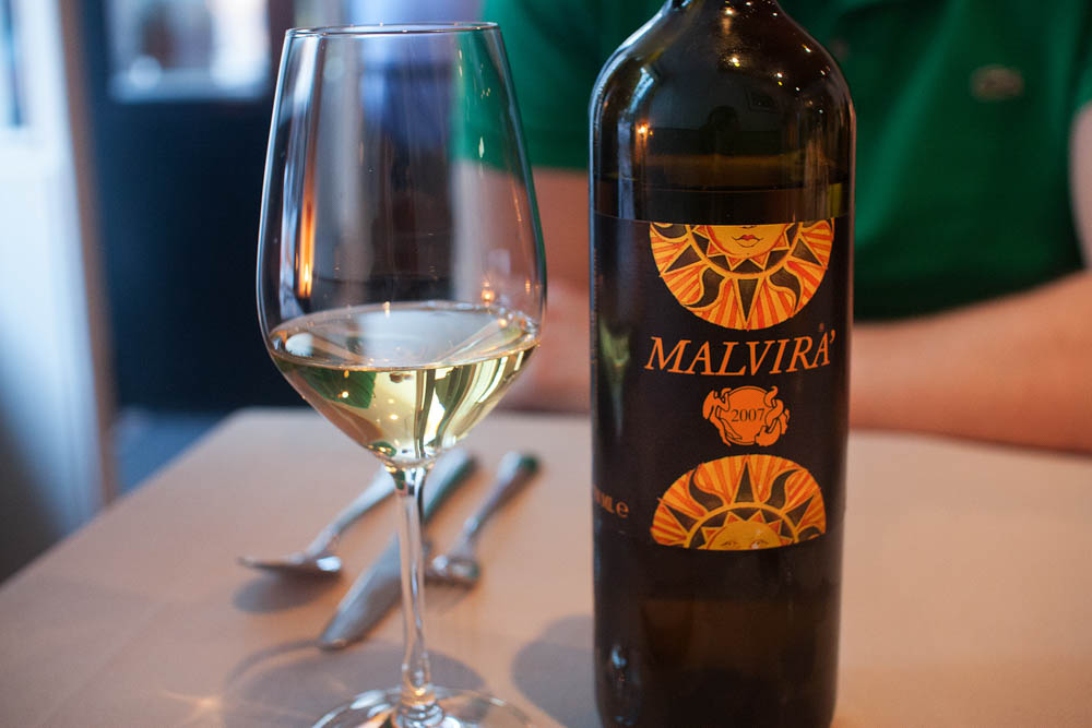 """Malvira 2007. Malvira means """"the wrong place"""", and the wine is named thus because the vineyard of the two brothers who make it is located on the North side of the hill, while the south side is where everyone wants to be. A complex and aromatic wine, with a hint of green fruits and citrus. Nice sweetness too. I was in wine heaven."""