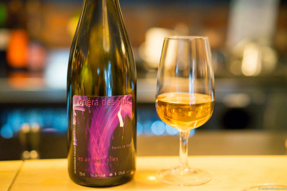 """We started of with a juicy, light Jean-Pierre Robinot: L'Opera des vins """"Les Années Folles"""". Yeast and stable odors hit the nose, but the taste is quite different. Acidic and fresh, but not something you would usually expect from a wine. """"It tastes like apple juice gone bad,"""" as my friend phrased it. He was kind of right, but it's still quite tasty in a weird way."""