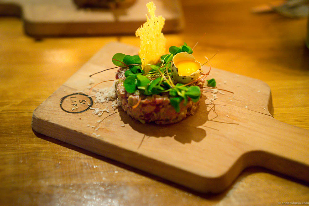 Horse tartare with a quail egg yolk, wood sorrel and parmesan chips