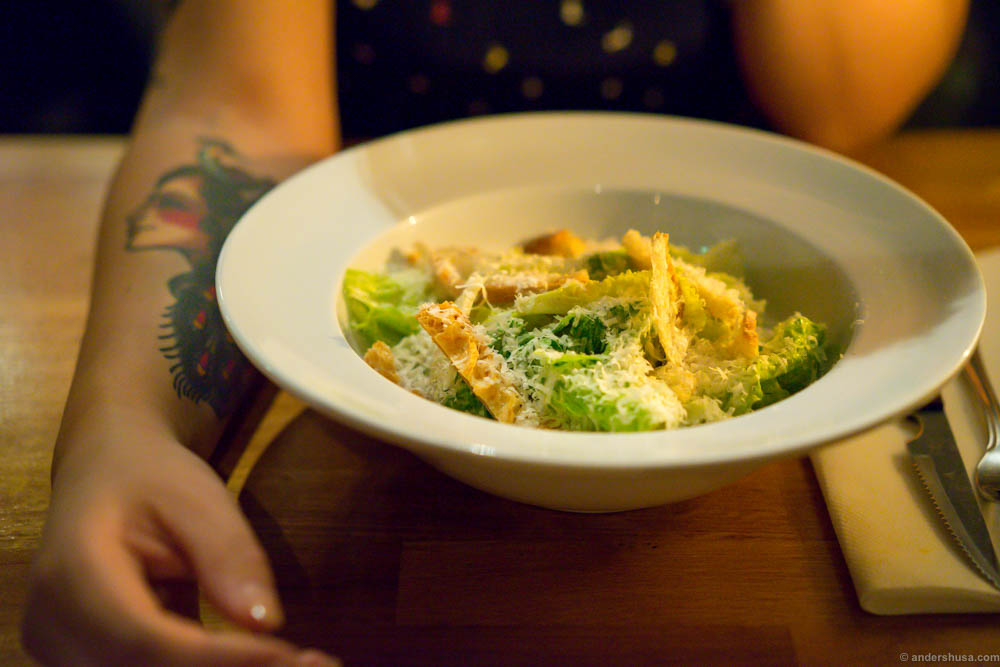 The Caesar salad at St. Lars is true to the original from 4th of July 1924, consisting only of romaine lettuce, croutons, parmesan cheese, lemon juice, olive oil, egg, Worcestershire sauce, garlic, and black pepper.