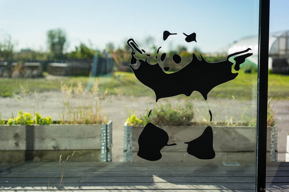 Panda with guns. Is it a Banksy or not?