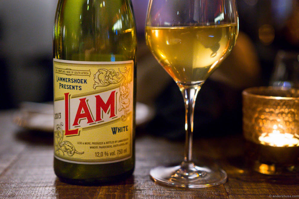Lammershoek LAM White. A great label! Like an old circus poster. A bio dynamic wine. Quite minerally, fresh, and a slight bitterness. Aroma of apple and apricots.