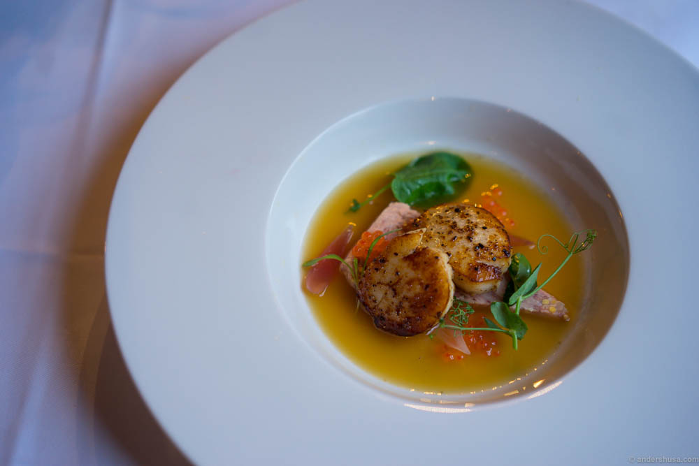 Perfectly fried king scallops, pork knuckle terrine, chanterelle broth, pickled onions and salmon roe.
