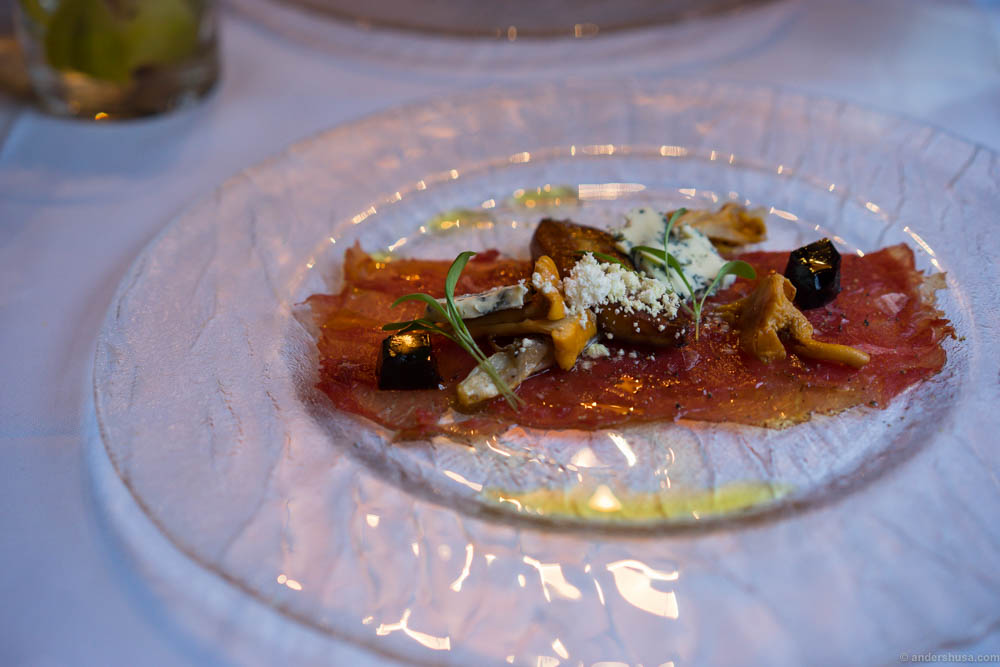 "Carpaccio of deer from Skåne, fried duck liver, pickled chanterelles, fried endive, ""Blåmandag"" blue cheese from Den Blinde Ku, ghoa cress, balsamic jelly & thyme ""snow"". A most wonderful presentation, and stunning looking dish, but there are way too many elements fighting for attention. The meat is so tender and tasty, the chanterelles are lovely, but the blue cheese steals most of the flavor."