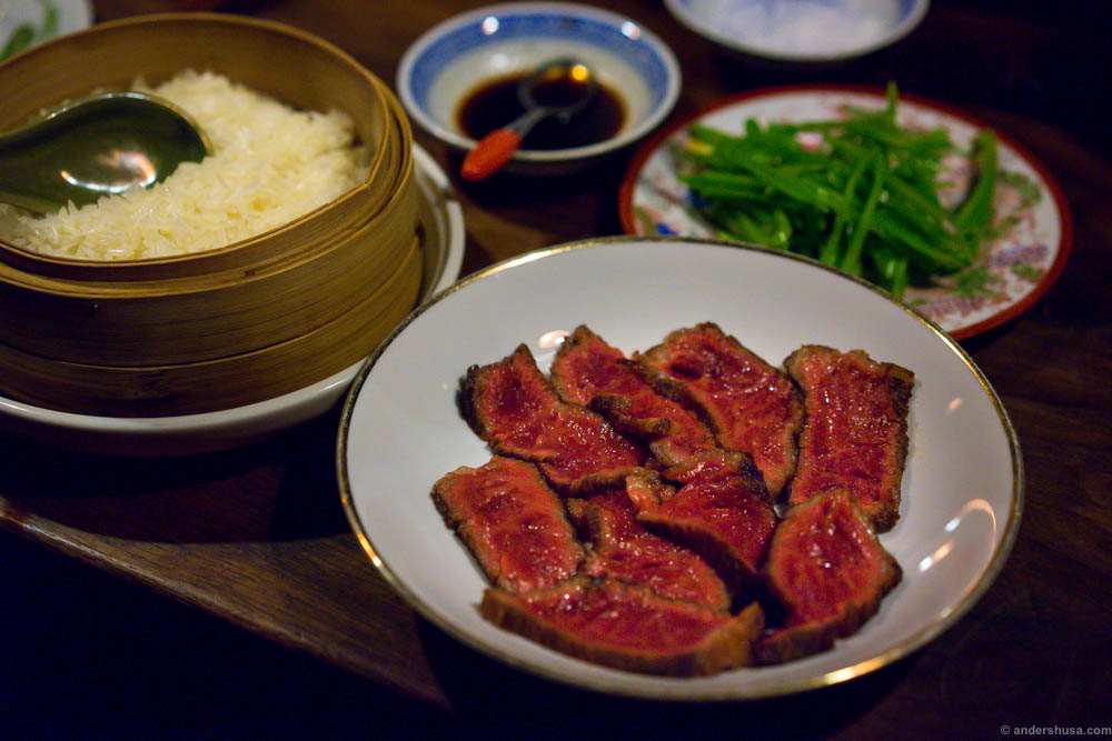 Kobe beef, lightly seared. So soft that it melts in your mouth and at the same time punches you with a rich umami flavor. Served with sticky rice, sugar snaps, soy sauce and salt.