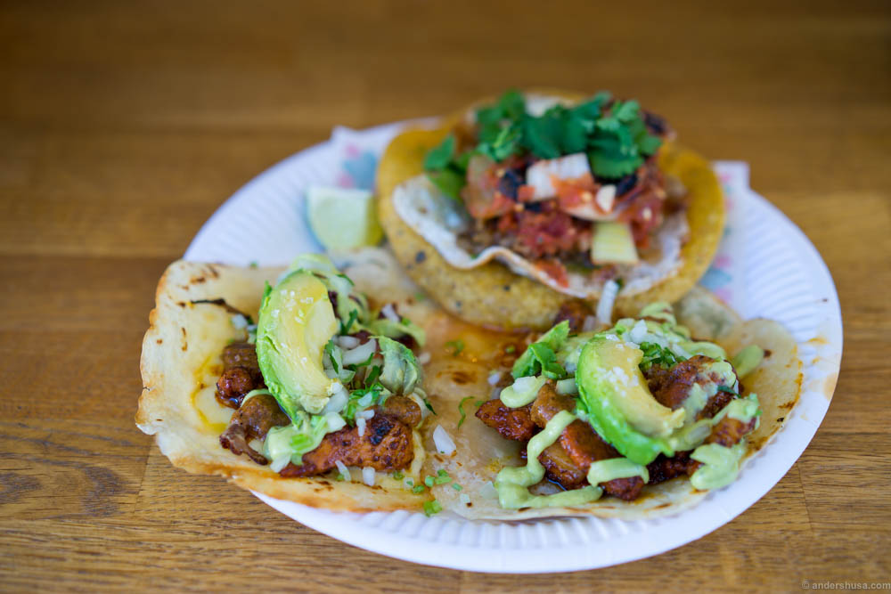 """Two """"gringas"""" in the front. Flour tortillas with melted two months aged cheese and al pastor marinated pork. One tostada with fried egg in the back."""