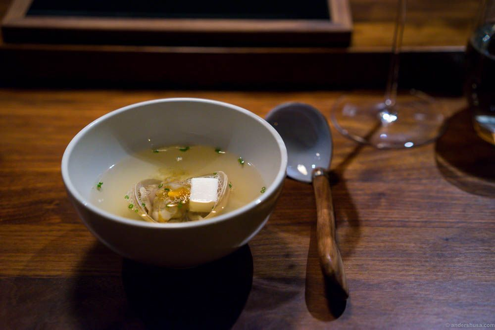 Suimono with tofu and cockle. Suimono is a light, clear Japanese soup typically served as an appetizer.