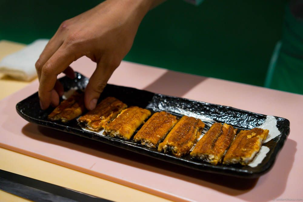 The eel is grilled and basted in unagi sauce in several stages. Roger also used sansho for flavoring - Japanese green pepper corns.