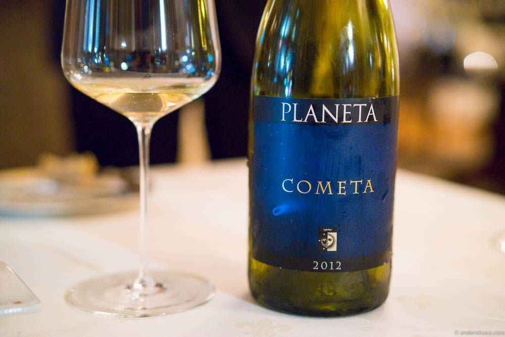 Planeta Cometa 2012. Love the name! Love the label. Love the taste! Green and yellow in color. Butter smooth like a good Chardonnay. A great pairing with the food.