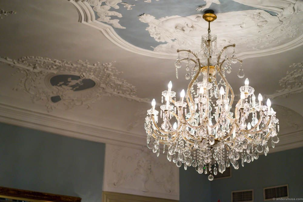 Chandeliers and a beautiful stucco ceiling. The stucco is from the 1700s and considered one of Norway's finest