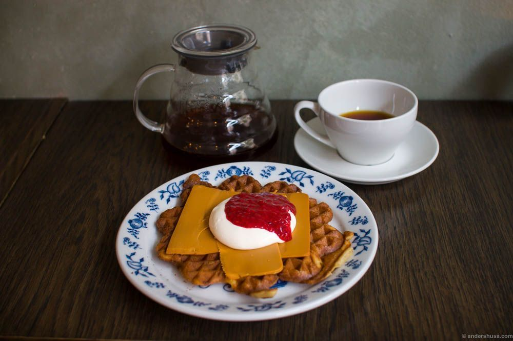 Classic Norwegian waffle with brown cheese, sour cream and jam
