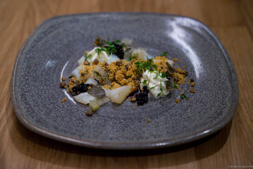 "Smoked haddock with fennel ""soil"", pickled fennel, fried halibut skin and avruga caviar. Make sure you eat all the elements together. Alone they are not that exciting, but united they'll tickle all your taste buds."