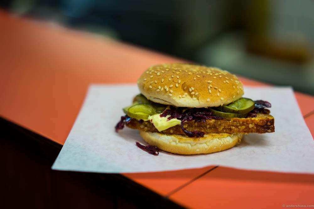 "The famous ""flæskestegsandwich"". Soft buns, crispy pork roast, fermented cabbage, pickled gherkins, and a Béarnaise sauce."