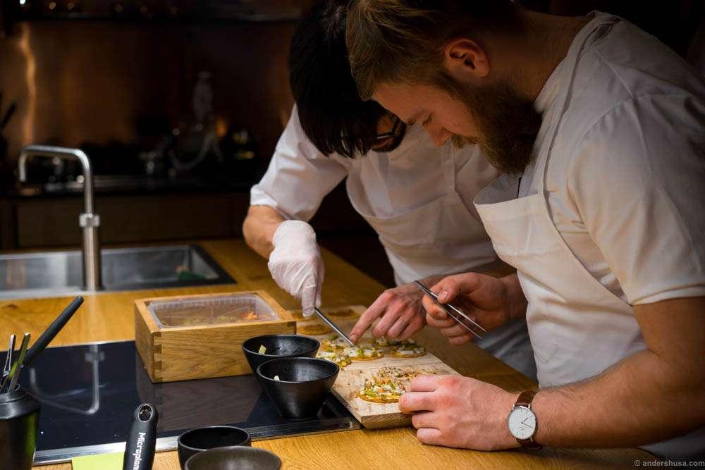 Chefs with tweezers