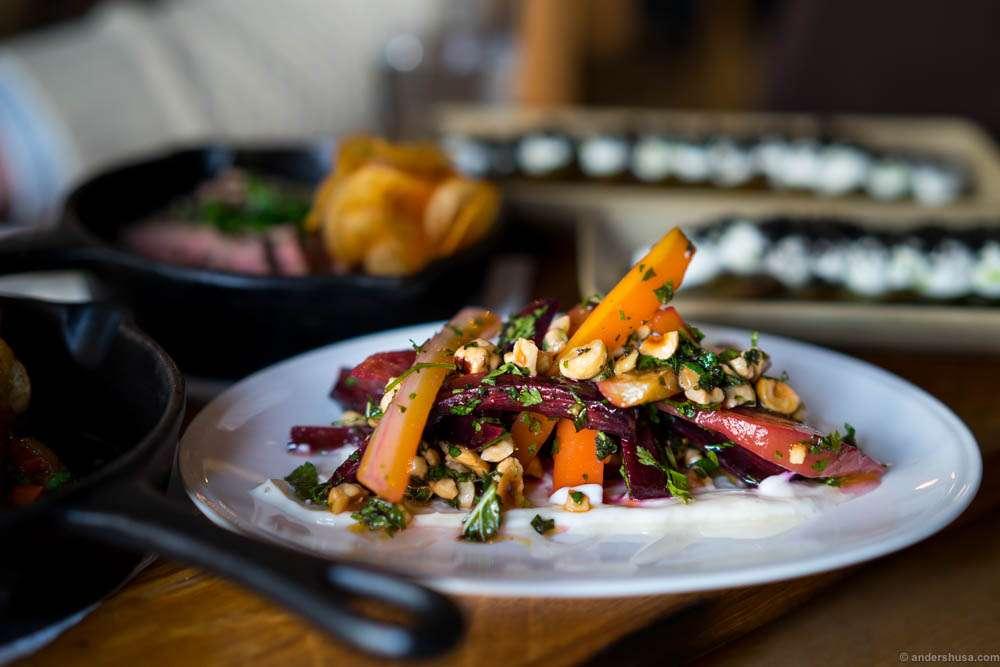 Confit carrots, polka beets, toasted hazelnuts, fresh cheese, cumin, chervil & mint