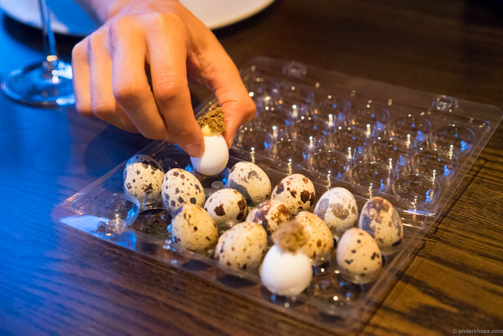 Quail egg and summer truffle. Careful, better pick the edible ones!