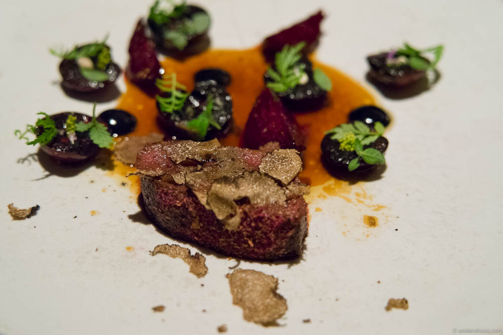 Loin of deer with grilled cherry, new beetroots, orange Tagetes & truffle