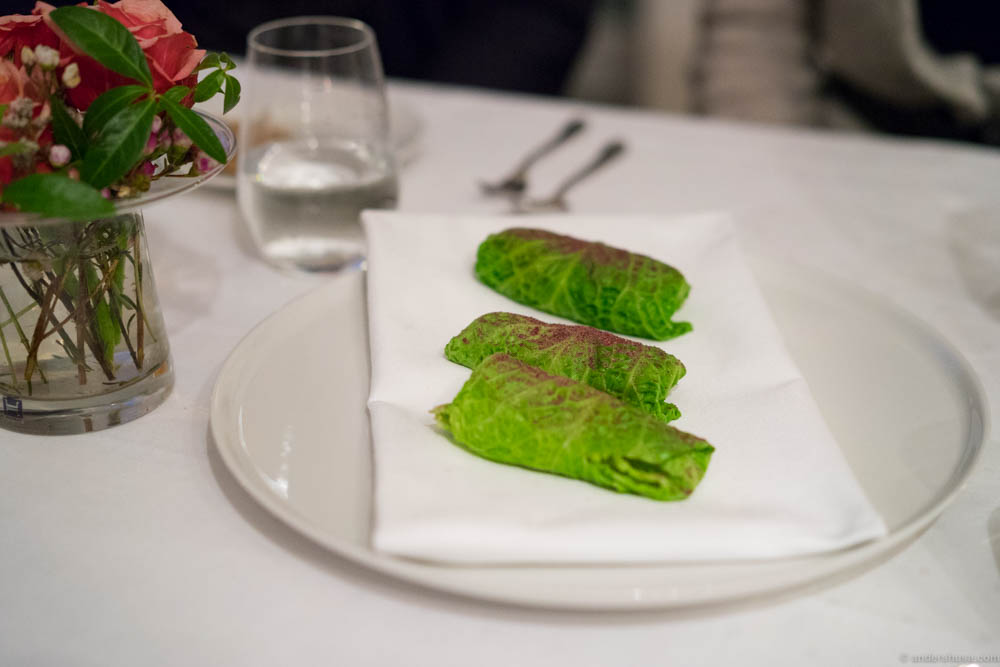 Cabbage rolls with oyster emulsion, sea lettuce, fried langoustine and rose hip powder