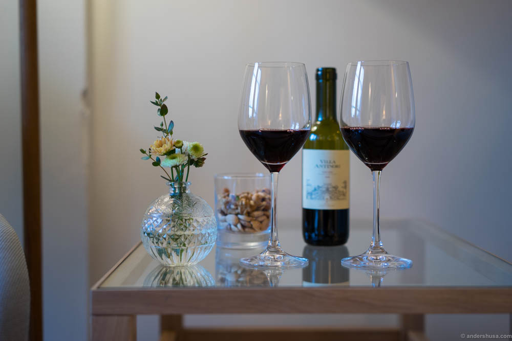 Enjoying a glass of Villa Antinori in our hotel room before dinner