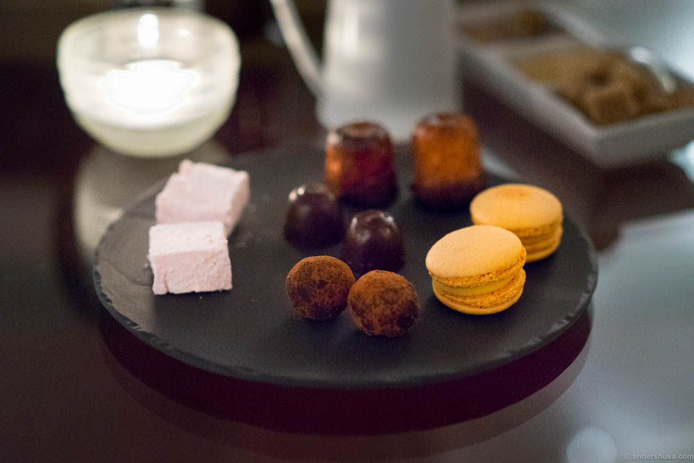 Petits fours. Canelés, macarons, marshmallows and chocolates