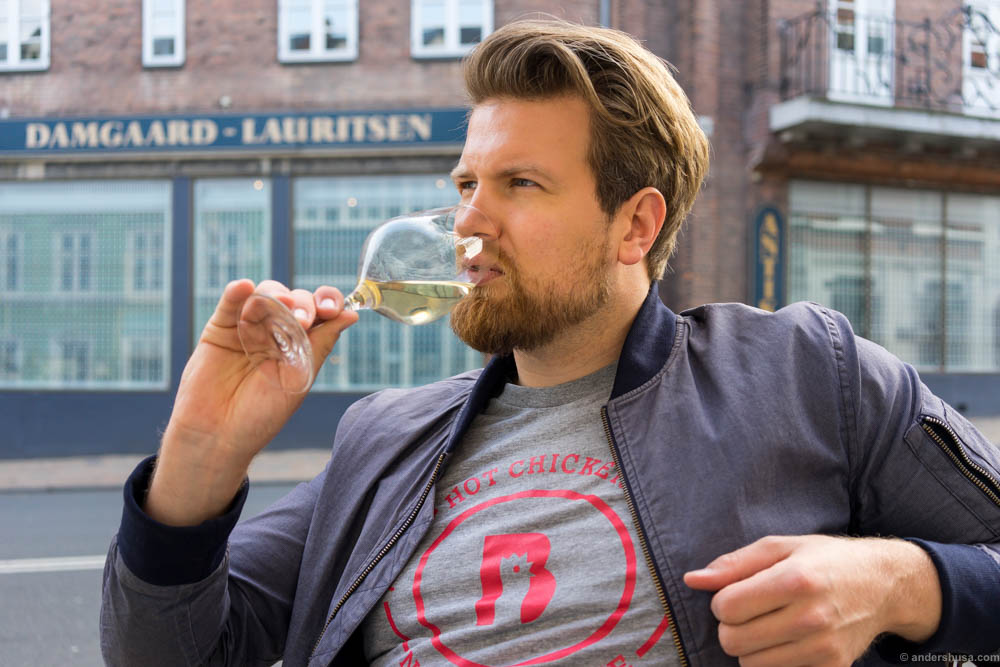 A foodie drinking wine at S'Vineriet wine bar in Odense, Denmark. Photo: Hedda Kaupang