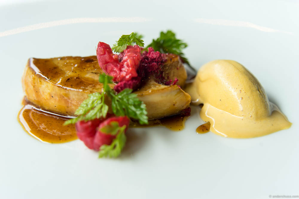 Pan fried foie gras with a sauce of vanilla and oxtail broth and a liquorice ice cream. Served with raspberries and chervil