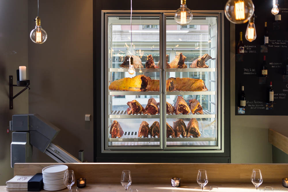 The cabinet of dry-aged cuts of meat