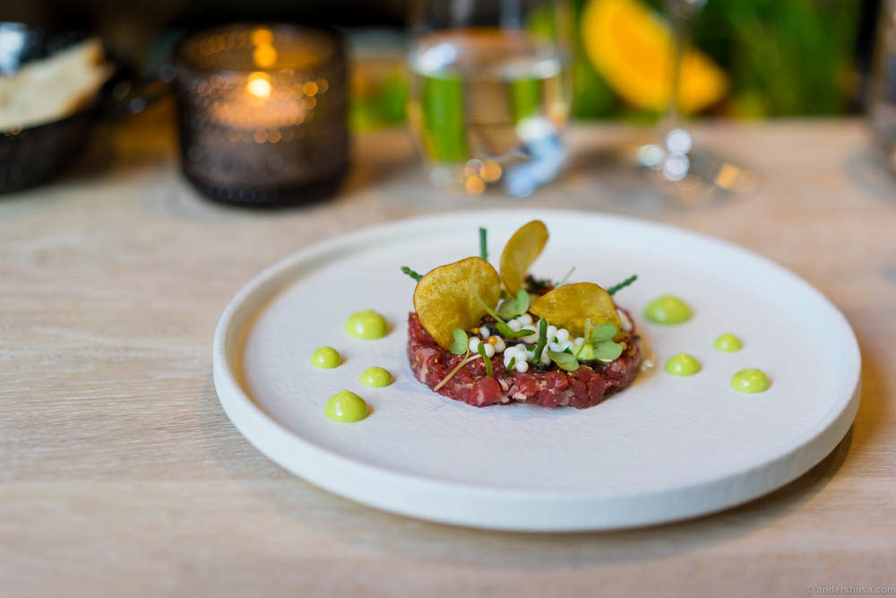 Tartare of dry aged beef with bone marrow, potato chips, tarragon emulsion & horseradish pearls