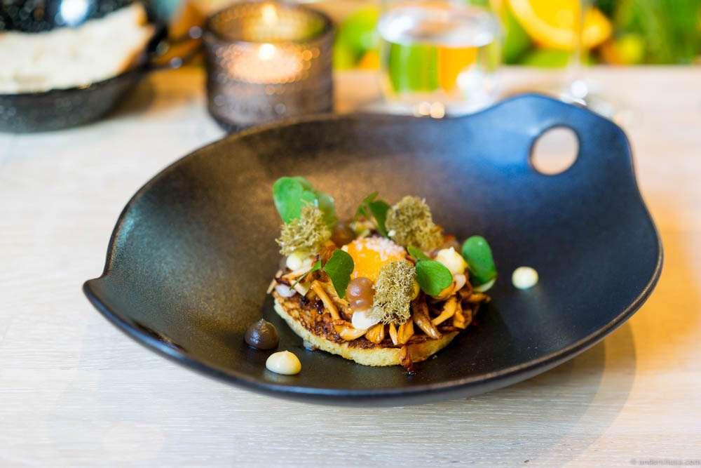 Brioche with chanterelles, reindeer moss, confit egg yolk, hazelnuts and sorrel
