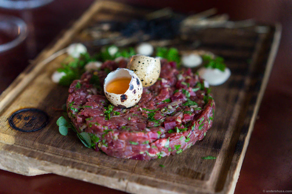 Horse tartare with pickled beets, wood sorrel, and quail eggs.