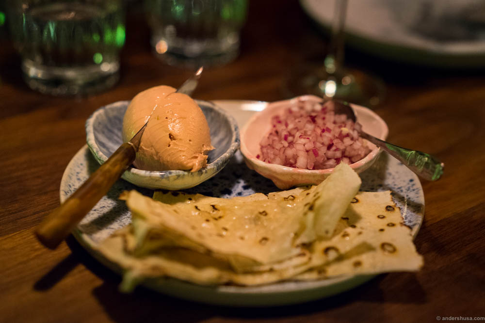 Duck liver with garlic bread and red onion at restaurant Pjoltergeist in Oslo, Norway
