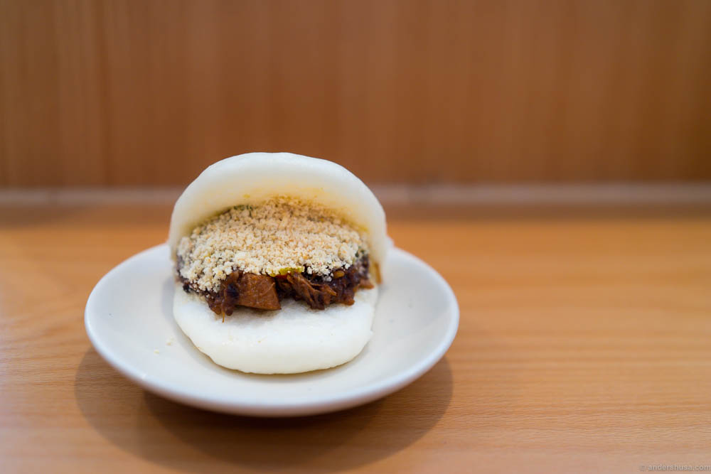 Classic bao with braised pork, peanut powder, fermented greens and coriander at restaurant Bao in London, UK.