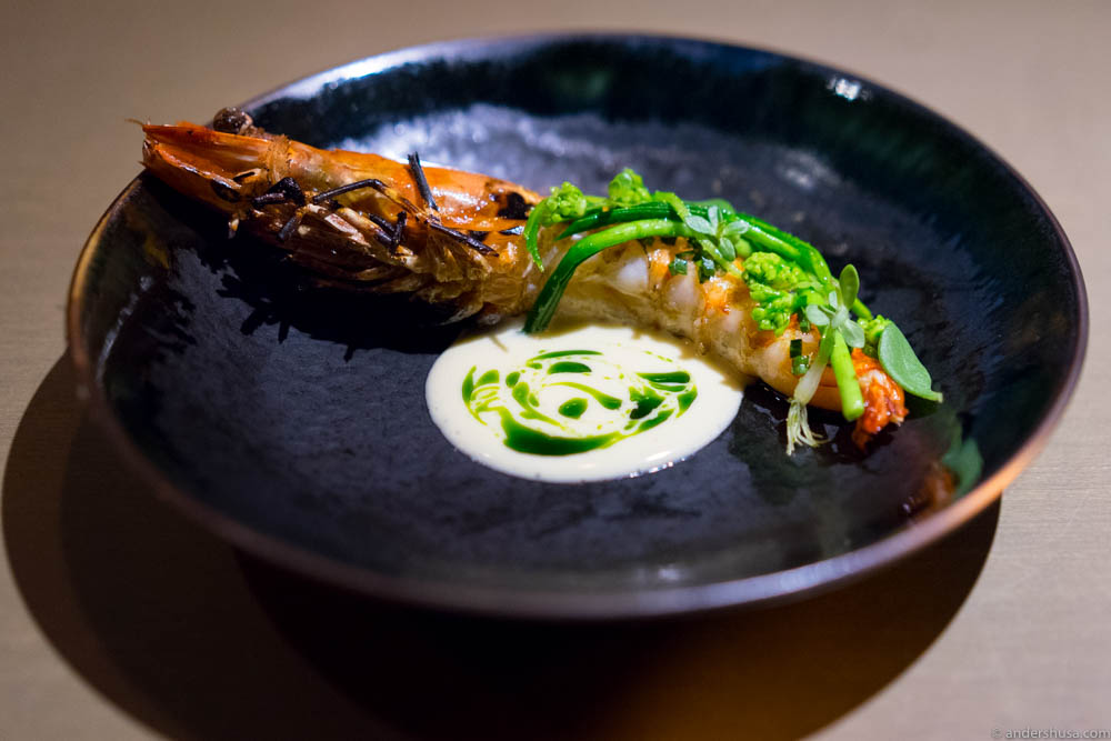 An off-menu item: Local tiger prawn char-grilled with rosemary & pawn butter from its own shell, served with three different types of chives, lemon beurre blanc and parsley & rosemary oil.