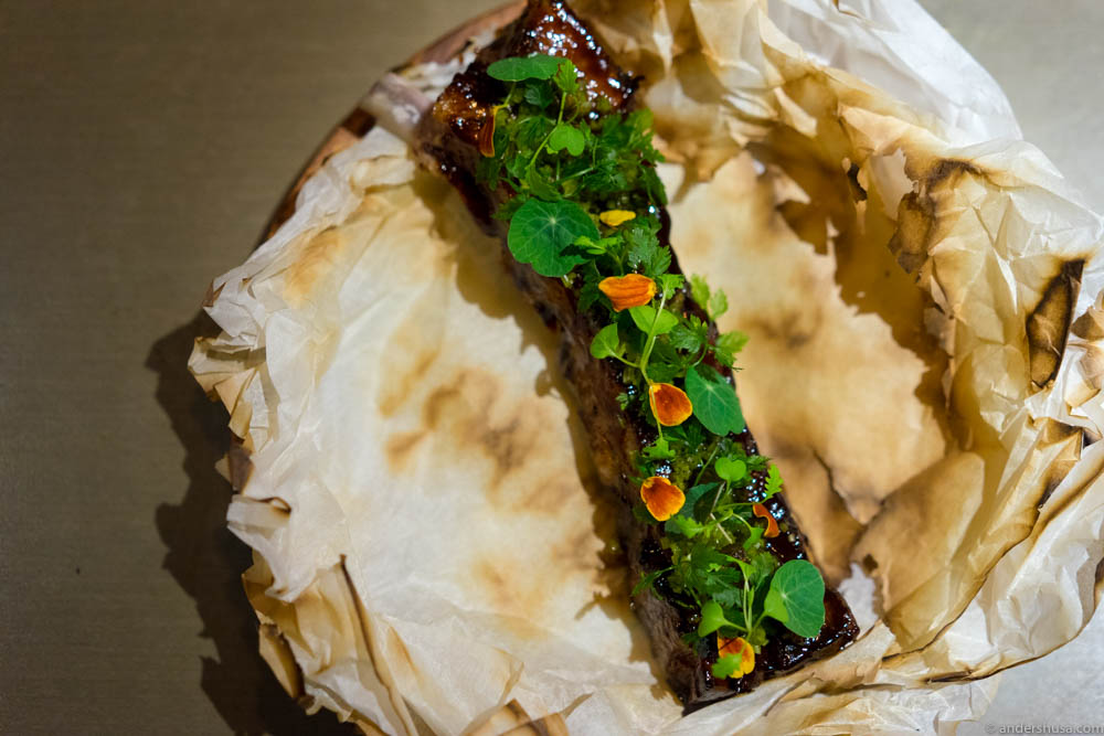 BBQ pork ribs with plum & miso glaze, capers and mustard greens