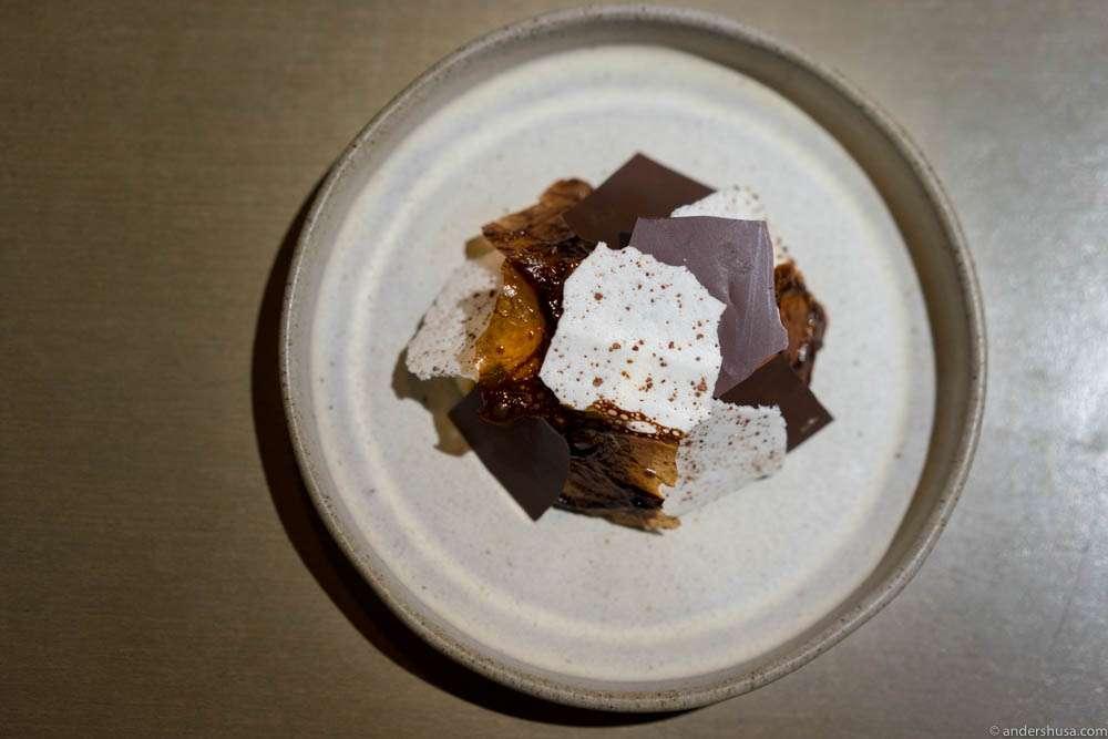 Cocoa crisps, smoked vanilla ice cream, roasted white chocolate & orange