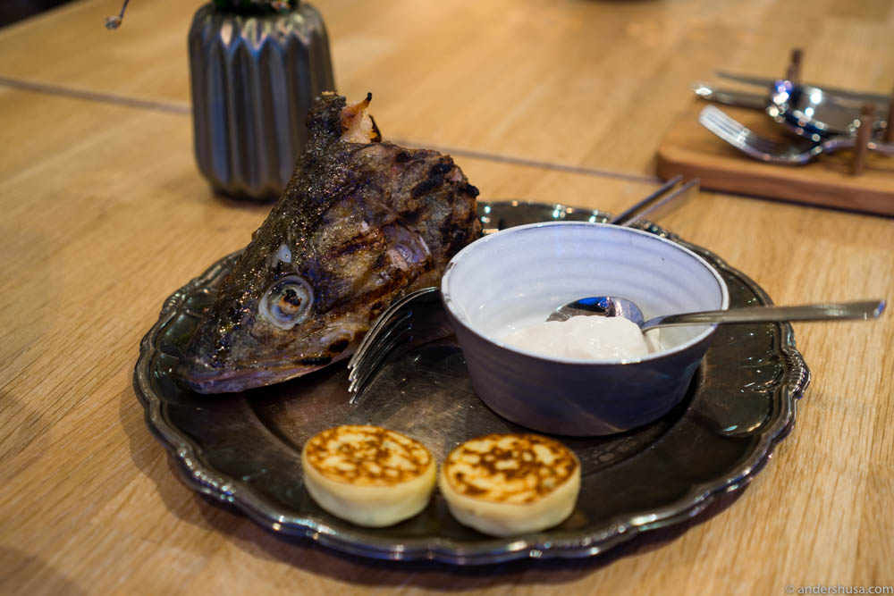 Fish head with potato blinis and smoked fish roe dip