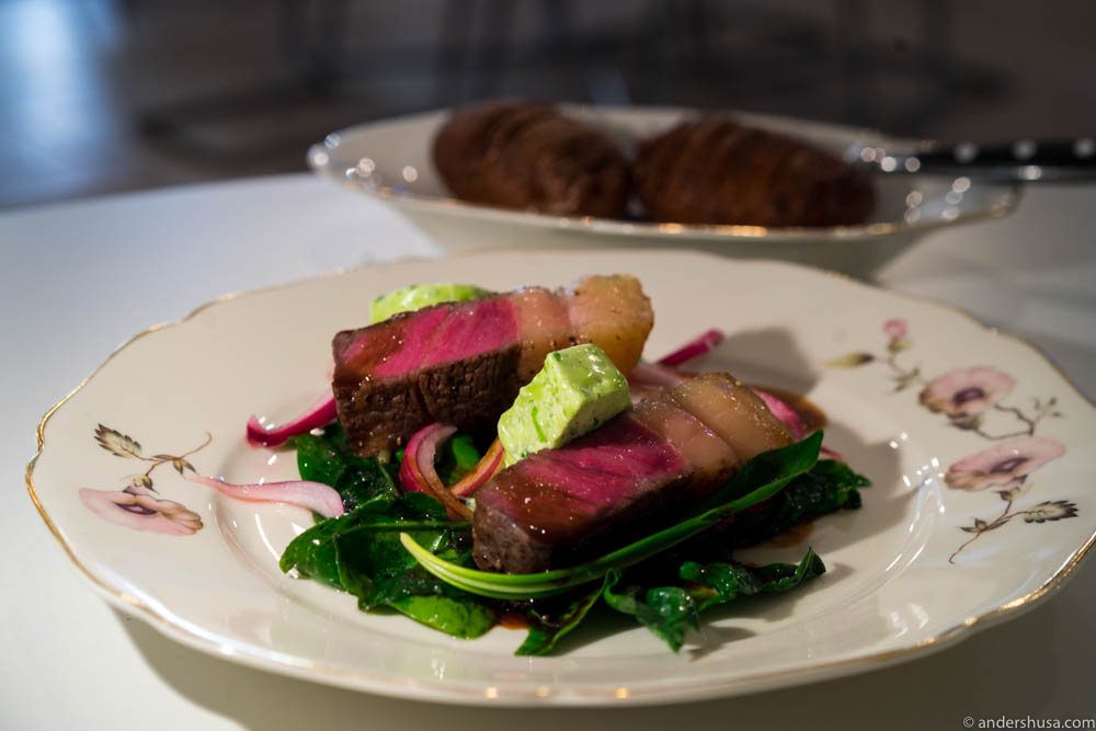 Sirloin from Scan dry aged from 13 of December. Chop of Linderöd pig from Jannelund. Ramson, spinach, pickled onions, red wine sauce, and Hasselback potatoes.