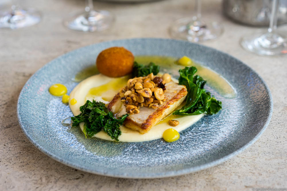 Turbot, cauliflower purée, butter, lemon gel, kale, hazelnuts & a bolinho