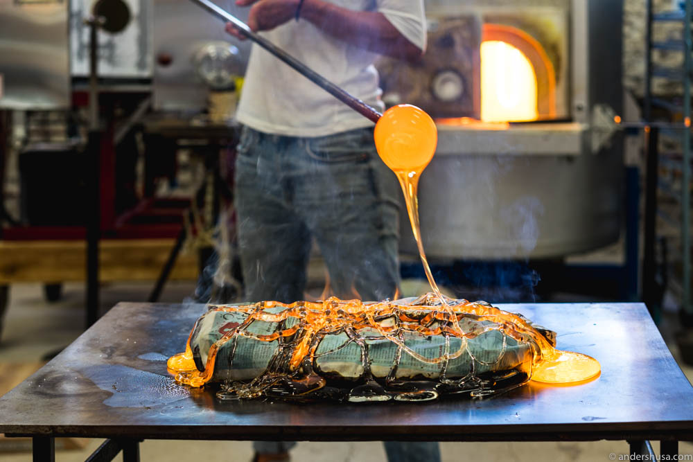 Jennie Olofsson applies a net of molten glass to the fish